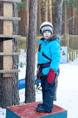 Boy in climbing gear, woods, winter — Stock Photo