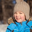 Small boy squinted at sun, winter, park — Stock Photo