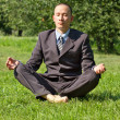 Businessman Meditating Outdoors — Stock Photo #10650567