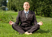 Businessman Meditating Outdoors — Stock Photo