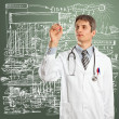 Doctor Male Writing Something — Stock Photo #8303832