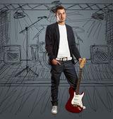 Kameraya bakarak gitar ile şık adam — Stok fotoğraf