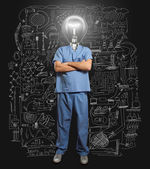 Lamp-head doctor male — Stock Photo
