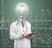 Lamphead doctor writing something — Stock Photo