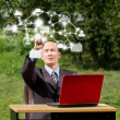 Man with Laptop Working Outdoors in Social Network — Stock Photo #9067632