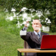 Man with Laptop Working Outdoors in Social Network — Stock Photo