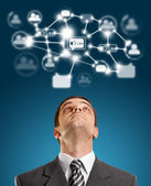 Businessman Looking Upwards in Social Network — Stock Photo