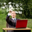 Mwith Laptop Working Outdoors in Social Network — Stock Photo #9405801
