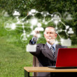 Man with Laptop Working Outdoors in Social Network — Stock Photo #9405810