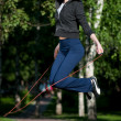 Jumping woman with skipping rope at park - Foto Stock
