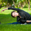 Woman doing stretching exercise. Yoga — Stock Photo