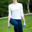 Woman doing exercise with dumbbell — Stock Photo #8457774