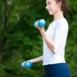 Woman doing exercise with dumbbell — Stock Photo #8457779