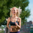 Sport woman running on street - Stock Photo
