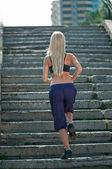 Sport woman running on street — Stock Photo