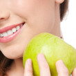 Young beauty woman with green apple — Stock Photo
