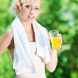 Woman drinking juice after exercise — Stock Photo