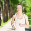 Young woman running in green park — Stock Photo #8461528