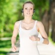 Young woman running in green park — Stock Photo #8462116