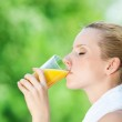 Woman drinking juice after exercise — Stock Photo #8462126