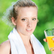 Woman drinking juice after exercise — Stock Photo #8462131