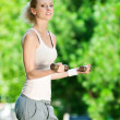 Woman doing dumbbell exercise outdoor — Stock Photo
