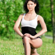 Stock Photo: Woman doing stretching exercise. Yoga