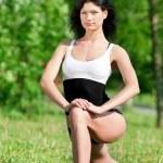 Woman doing stretching exercise. Yoga — Stock Photo