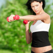 Woman doing exercise with dumbbell — Stock Photo