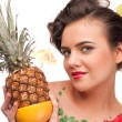 Close up portrait of young emotional woman with pineapple and gr — Stock Photo #8463433