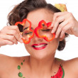 Close up portrait of young emotional woman with red pepper — Stock Photo #8463458