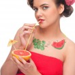 Close up of young woman that drink grapefruit juice. — Stock Photo #8463460
