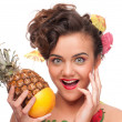 Close up portrait of young emotional woman with pineapple and gr - Stock Photo