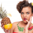 Close up portrait of young emotional woman with pineapple and gr — Stock Photo