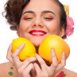 Close up portrait of beauty woman with lemon and grapefruit — Stock Photo #8463634