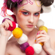 Closeup fashion woman with color face art in knitting style — Stock Photo