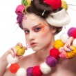 Closeup fashion woman with color face art in knitting style — Stock Photo #8466380