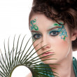 Royalty-Free Stock Photo: Close-up of sprite girl with faceart and plant