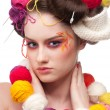 Stock Photo: Closeup fashion womwith color face art in knitting style