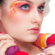 Closeup fashion woman with color face art in knitting style — Stockfoto