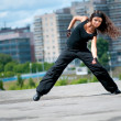 Stock Photo: Beautiful girl dancing hip-hop over urblandscape
