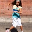 Beautiful teenage girl dancing hip-hop — Stock Photo