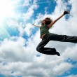 Beautiful girl dancing against the sky — Stock Photo