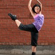 Beautiful teenage girl dancing hip-hop — Stock fotografie