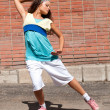 Beautiful teenage girl dancing hip-hop — Lizenzfreies Foto