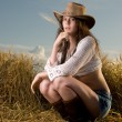 Beautiful slavonic girl in cowboy clothes — Stock Photo