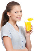 Young woman with glass of orange juice isolated — Stock Photo