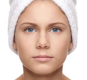 Full symmetrical face of girl with towel — Stock Photo