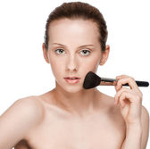 Beautiful young adult woman applying cosmetic brush — Stock Photo