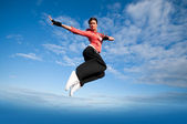 Sport woman jumping and fly over sky — Stock Photo